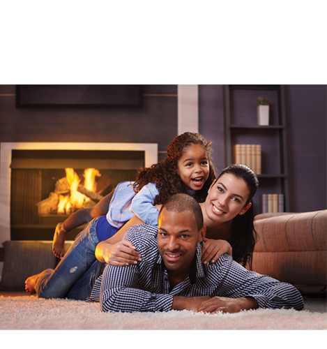 Smiling family in Front of Propane Fireplace